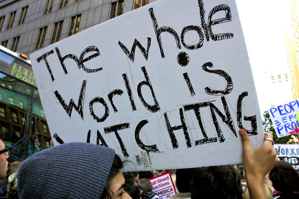 OWS_19_Whole_World_is_Watching.jpg